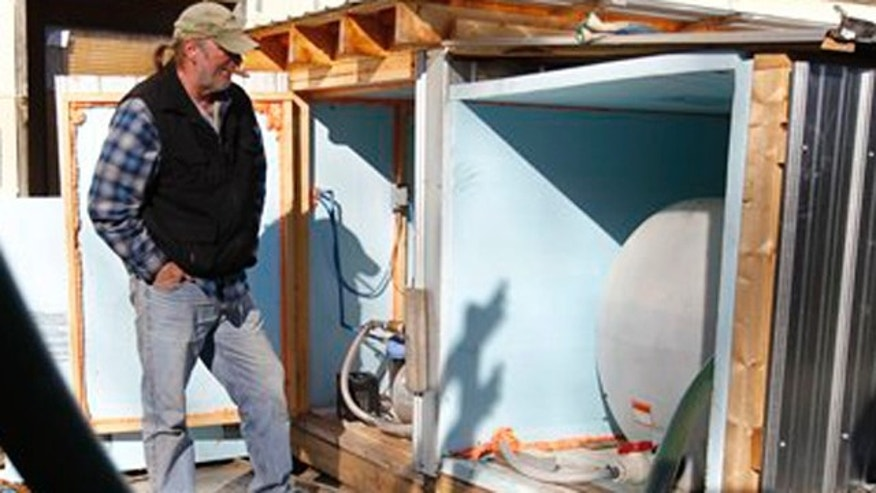 Feb. 13, 2012 : Ray Kemble pumps drinking water into tanks along side his home in Dimock, Pa.