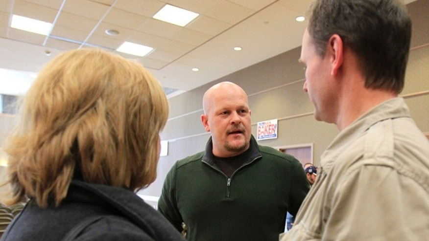 Feb. 24, 2012: Republican congressional candidate Samuel Wurzelbacher, better known as Joe the Plumber, talks with supporters after giving a speech in Rocky River, Ohio. Wurzelbacher faces longtime Democratic Rep. Marcy Kaptur in the general election.