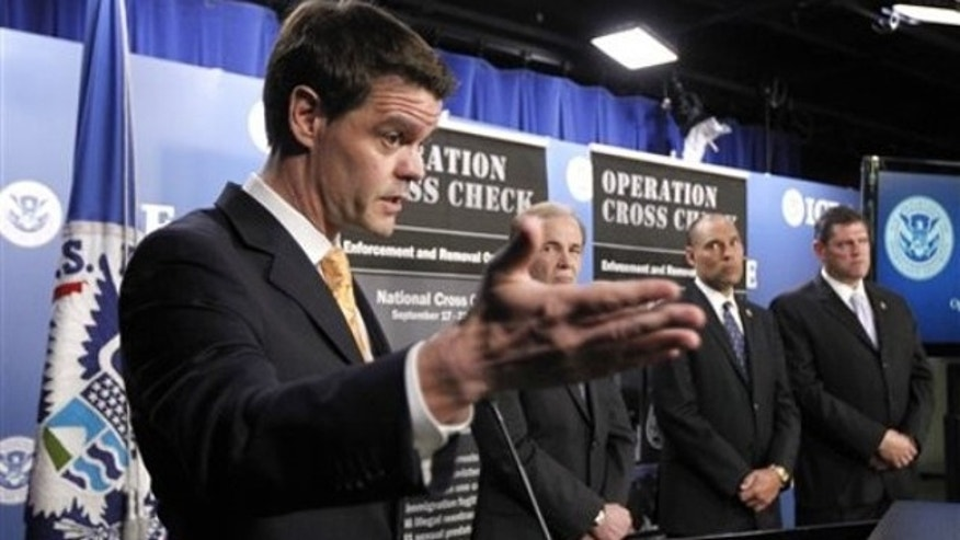 Sept. 28, 2011: Immigration and Customs Enforcement Director John Morton, left, speaks at a news conference in Washington alongside other immigration officials.