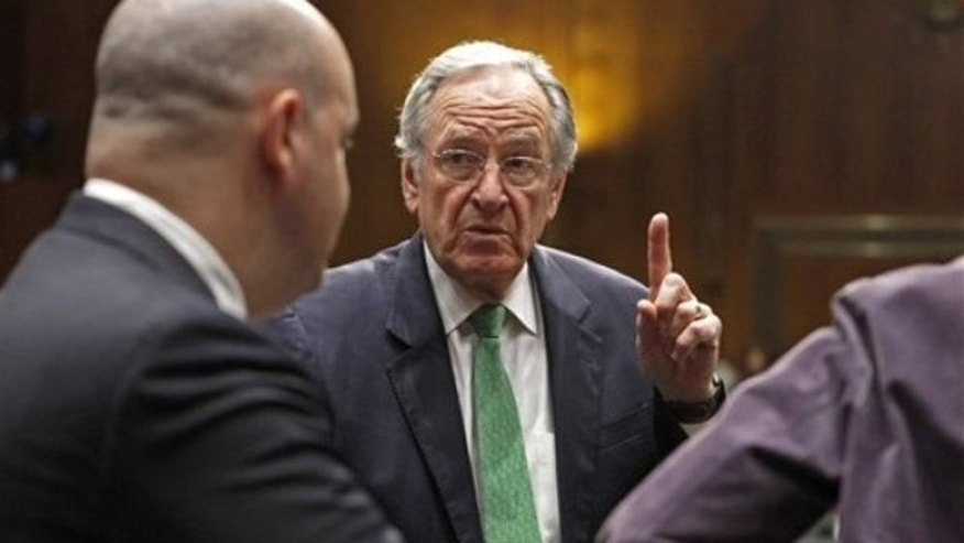 Oct. 19, 2011: Sen. Tom Harkin speaks to a staff member on Capitol Hill in Washington.