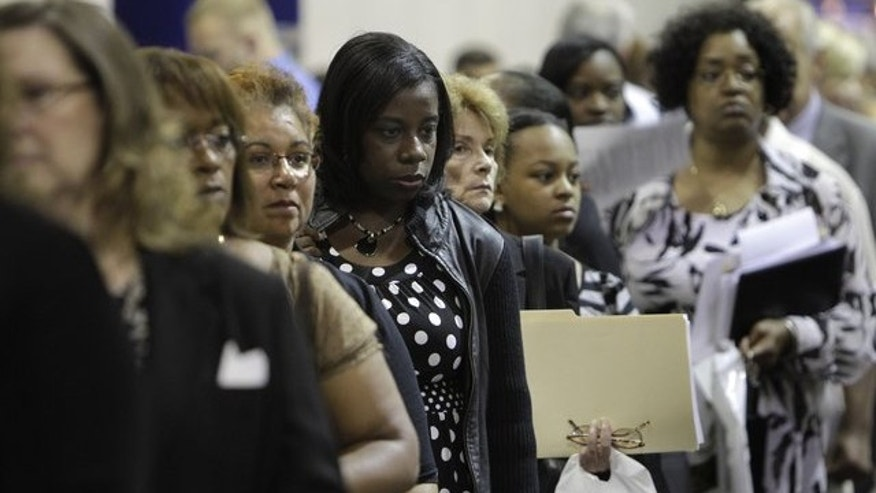 Aug. 25, 2010: Job seekers stand in line at a job fair outside Detroit.