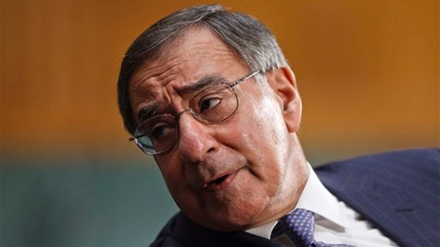 March 7, 2012: Defense Secretary Leon Panetta confers with an aide on Capitol Hill in Washington.