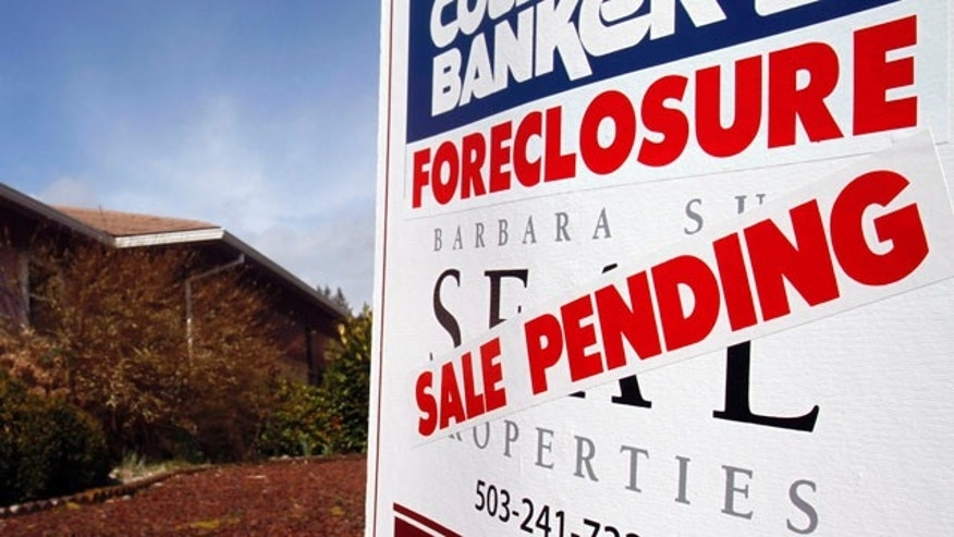 March 8: A foreclosed house with sale pending sign is shown in Tigard, Ore. The number of Americans who owe more on their mortgages than their homes are worth rose at the end of last year, preventing many people from selling their homes in an already weak housing market.
