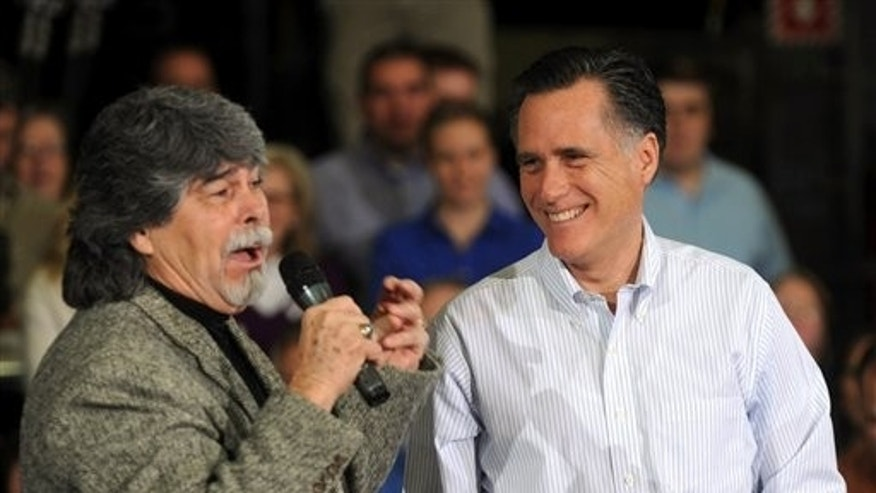 March 9: Republican presidential candidate, former Massachusetts Gov. Mitt Romney listens as Randy Owen of the band Alabama sings 'My Home's in Alabama' during a campaign stop at Thompson Tractor in Tarrant, Ala., near Birmingham.
