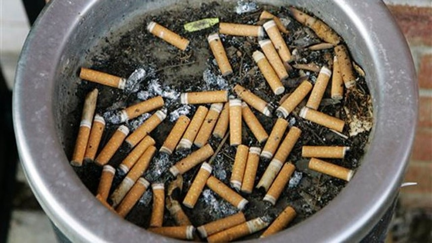 An ashtray full of cigarette butts is shown in Omaha, Neb., in this March 28, 2007, file photo.