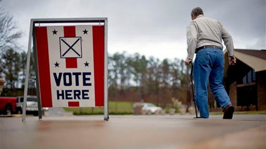 March 13, 2012: A voter leaves a polling place in Birmingham, Ala.