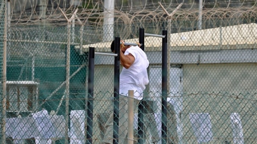 April 27, 20120: In this photo, reviewed by a U.S. Department of Defense official, a Guantanamo detainee does pull-ups inside an exercise area at the detention facility at Guantanamo Bay U.S. Naval Base.