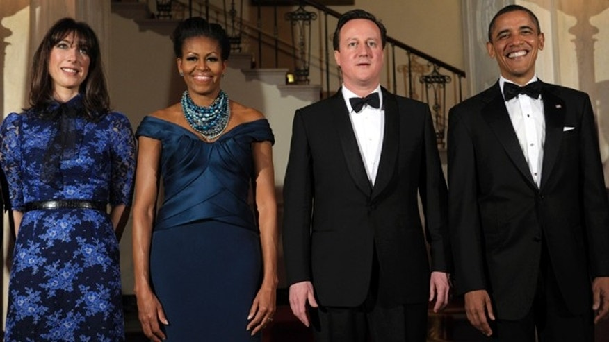 March 14, 2012: President Barack Obama and first lady Michelle Obama pose for an official photo with British Prime Minister David Cameron and his wife, Samantha Cameron, at the White House in Washington before a State Dinner.