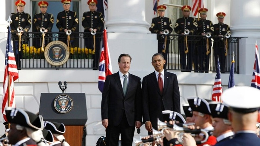 March 14, 2012: President Obama welcomes British Prime Minister David Cameron during an official arrival ceremony on the South Lawn of the White House.