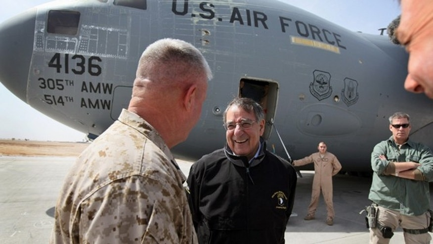 March 14, 2012: Defense Secretary Leon Panetta is greeted upon his arrival at Camp Bastion, Afghanistan. Panetta is scheduled to meet with troops and with President Karzai during his two-day visit to Afghanistan.