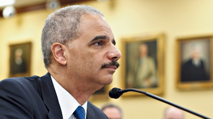 Attorney General Eric Holder testifies on Capitol Hill in Washington, Tuesday, Feb. 28, 2012, before a House Appropriations subcommittee hearing on the Justice Department's fiscal 2013 budget. (AP Photo/J. Scott Applewhite)