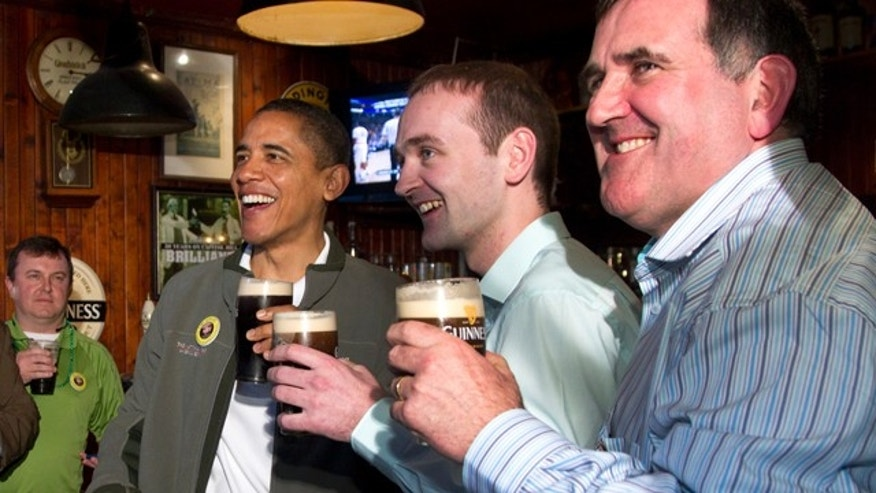 March 17: President Obama drinks a Guinness with his ancestral cousin from Moneygall Ireland Henry Healy, center, and the owner of the pub in Moneygall Ireland, Ollie Hayes, right, at The Dubliner Restaurant and Pub in Washington.
