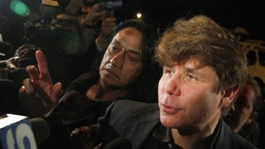 March 15, 2012: FILE - In this file photo, former Illinois Gov. Rod Blagojevich departs his Chicago home for Littleton, Colo., to begin his 14-year prison sentence on corruption charges.