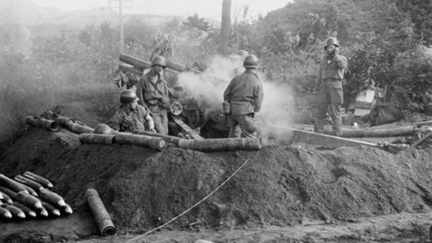 July 10, 1950: In this back-and-white file photo, American GIs fire a 105 Howitzer gun in action against North Korean invaders somewhere in Korea.