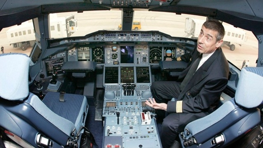 March 26, 2007: Airbus A380 pilot Jean-Michel Roy sits in the cockpit of the aircraft on the tarmac at Washington Dulles International Airport in Dulles, Virginia.