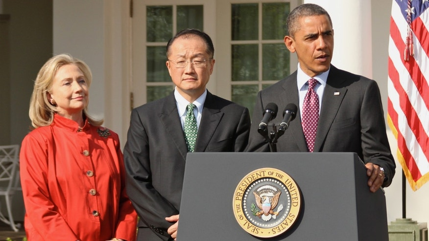 President Barack Obama stands with Jim Yong Kim, his nominee to be the next World Bank President, and Secretary of State Hillary Rodham Clinton, during an announcement in the Rose Garden at the White House, in Washington, Friday, March 23, 2012.