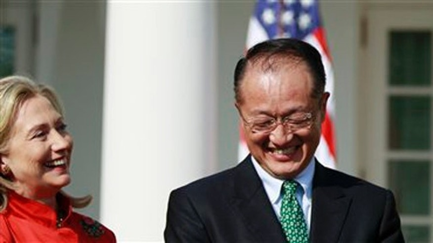 President Barack Obama stands with Jim Yong Kim, his nominee to be the next World Bank President, and Secretary of State Hillary Rodham Clinton, during an announcement in the Rose Garden of the White House in Washington, Friday, March 23, 2012. Kim is currently the president of Dartmouth College. (AP Photo/ Haraz N. Ghanbari)