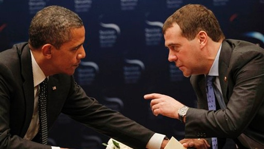 March 26, 2012: President Obama chats with Russian President Dmitry Medvedev during a bilateral meeting at the Nuclear Security Summit in Seoul, South Korea.