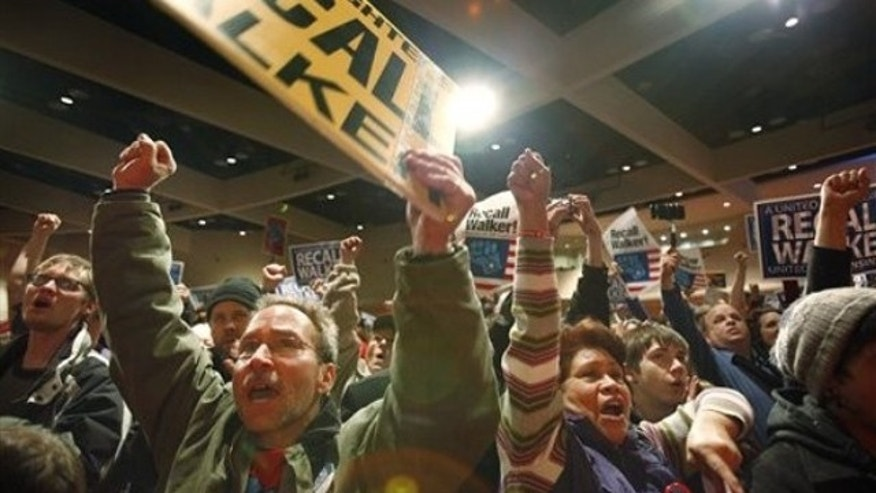 Jan. 17, 2012: The crowd cheers during a victory party for the Wisconsin recall effort in Madison, Wis.
