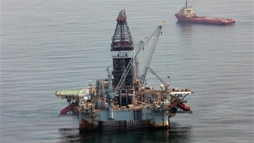 FILE: A deepwater drilling rig operates near the site of the Deepwater Horizon disaster in the Gulf of Mexico on June 8, 2010.