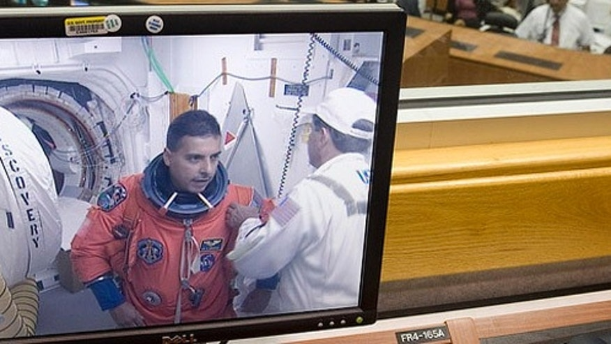 NASA Astronaut José Herá¡ndez is seen preparing to board the space shuttle Discovery at pad 39a on a monitor in Firing Room Four of the Kennedy Space Center at Cape Canaveral, Fla., Monday, Aug. 24, 2009.  Discovery is scheduled to launch Tuesday, Aug., 25, 2009 at 1:36 a.m. EDT and will carry the Leonardo supply module to the International Space Station during STS-128, along with a new crew member for the station, Nicole Stott.  Photo Credit: (NASA/Bill Ingalls)