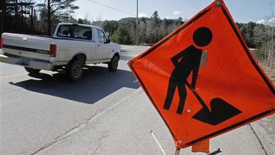March 21, 2012: A road work sign sits along a road in East Montpelier, Vt.