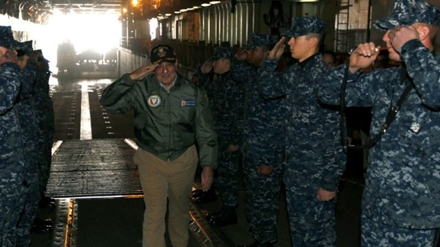 March 30, 2012: U.S. Secretary of Defense Leon Panetta, center, salutes as he is piped aboard the USS Peleliu upon his arrival at Camp Pendleton, Calif.
