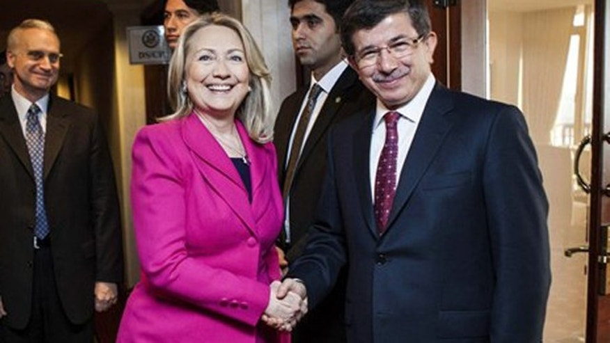 Mar. 31, 2012: U.S. Secretary of State Hillary Rodham Clinton, second left, and Turkish Foreign Minister Ahmet Davutoglu shake hands before a bilateral meeting at a hotel.