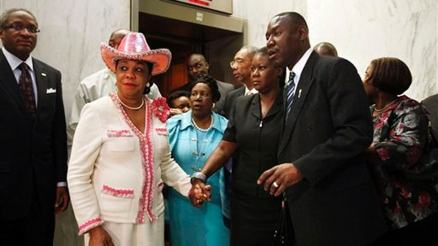 March 27, 2012: Rep. Frederica Wilson, left, holds hands with Sybrina Fulton, mother of Trayvon Martin, on their way to speak at a news conference on Capitol Hill.