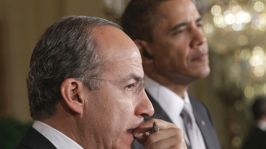 President Barack Obama and Mexico's President Felipe Calderon listen to a question during thier joint news conference in the East Room of the White House in Washington, Thursday, March 3, 2011. (AP Photo/Charles Dharapak)
