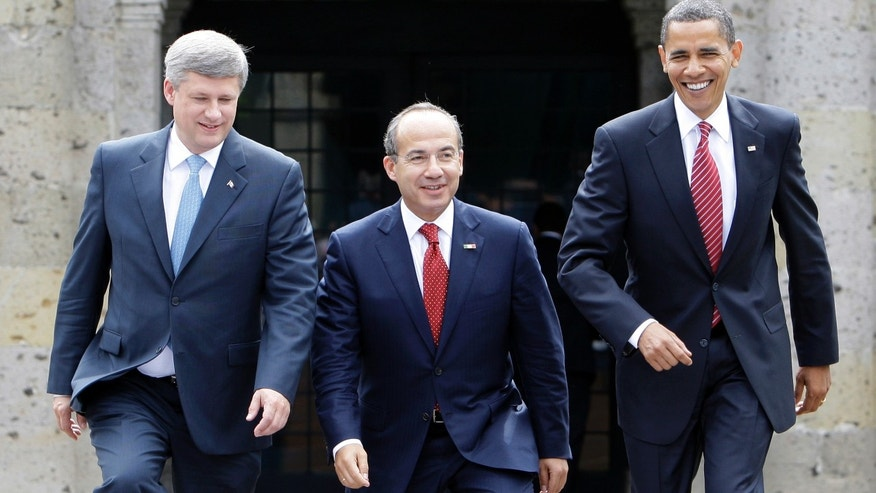 In this Aug. 10, 2009, photo, President Barack Obama, right, Mexico's President Felipe Calderon, center, and Canada's Prime Minister Stephen Harper walk towards a stand for an official photo in Guadalajara, Mexico, for a North American summit. (AP Photo/Alex Brandon, File)