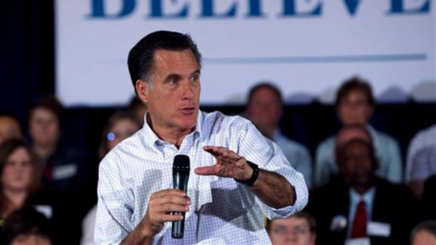 April 1, 2012: Mitt Romney speaks to a crowd at a town-hall style campaign event in Madison, Wis.