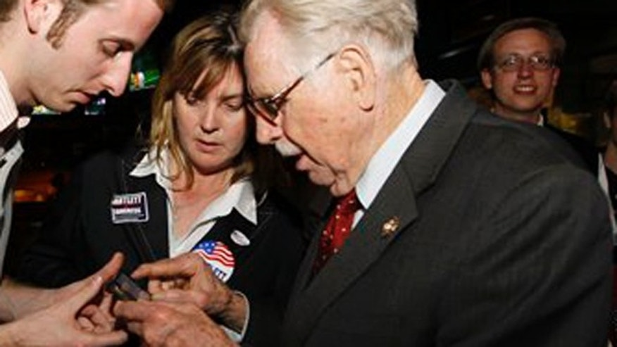 April 3, 2012: U.S. Rep. Roscoe Bartlett, R-Md., right, looks at primary election results with staffer James Wesolek, left, and chief of staff Deborah Burrell, center, in Frederick, Md.