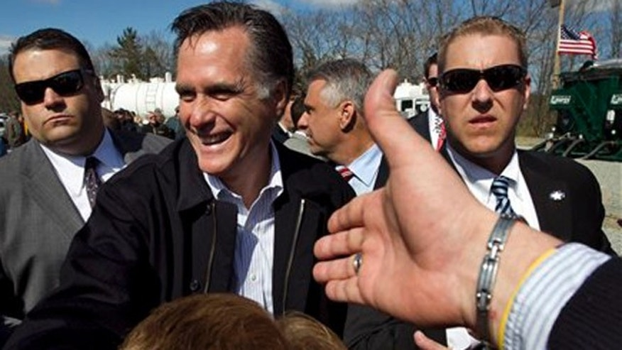 Republican presidential candidate, former Massachusetts Gov. Mitt Romney greets people in the crowd following a campaign event at an energy services company in Tunkhannock, Pa. April 5, 2012.