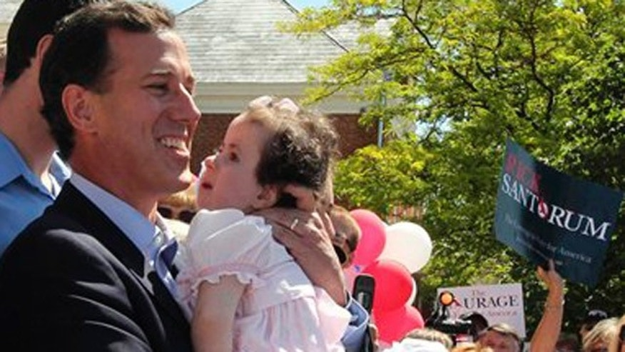 FILE - In this June 6, 2011 file photo, Republican presidential candidate, former Pennsylvania Sen. Rick Santorum holds his daughter Isabella in Somerset. The ill daughter of Republican presidential candidate Rick Santorum has been hospitalized. Santorum's campaign said Friday that Bella had been taken to an undisclosed hospital. The 3-year-old has the rare genetic condition Trisomy 18 and was hospitalized earlier this year with pneumonia. Santorum's campaign did not say why she was hospitalized.  (AP Photo/Gene J. Puskar, File)