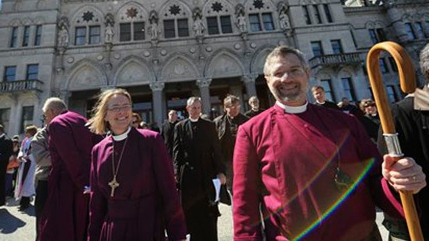 April 3, 2012: Bishop Laura Ahrens, left, and Bishop Ian Douglas, right, rally at the state Capitol with religious leaders who oppose the death penalty march in favor of repealing the punishment at state level in Hartford, Conn.