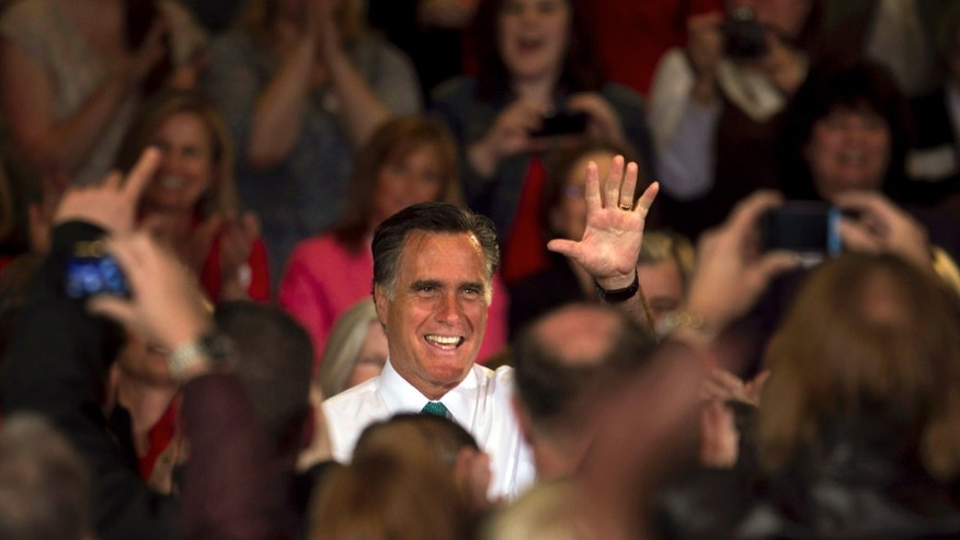 April 11: Republican presidential candidate, former Massachusetts Gov. Mitt Romney, waves before addressing an audience during a campaign event, in Warwick, R.I.