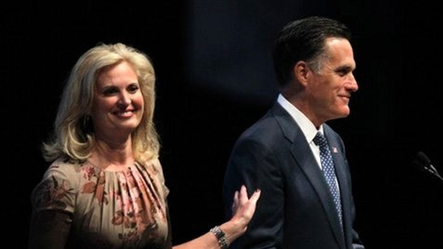 Republican presidential candidate, former Massachusetts Gov. Mitt Romney, accompanied by his wife Ann, prepares to speak at the National Rifle Association convention in St. Louis, Friday, April 13, 2012. (AP Photo/Michael Conroy)