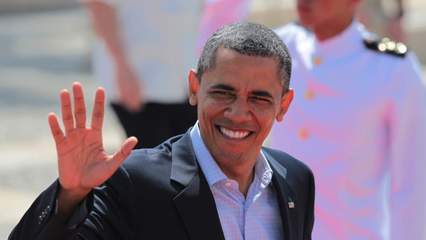 April 15: President Obama waves as he arrives at the Convention Center for the second working session of the sixth Summit of the Americas in Cartagena, Colombia.