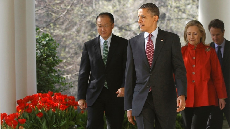 March 23, 2012: President Barack Obama walks with Jim Yong Kim, his nominee to be the next World Bank President, Secretary of State Hillary Rodham Clinton, and Treasury Secretary Timothy Geithner to the Rose Garden of the White House in Washington. Kim is currently the president of Dartmouth College.