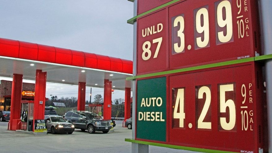 Gas prices are posted at a gas station in Breezewood, PA.