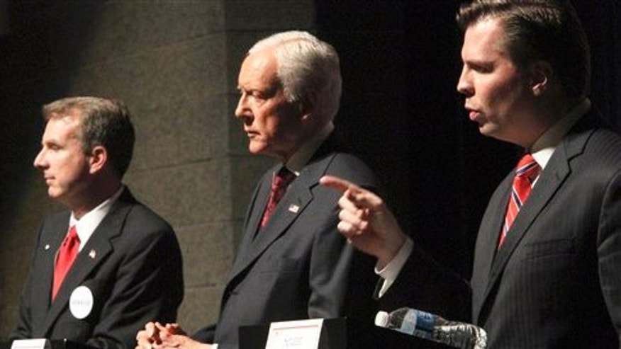 FILE : April 4: Utah Sen. Orrin Hatch, center, faces off with primary candidates Chris Herrod, left, and and Dan Liljenquist, during a debate.