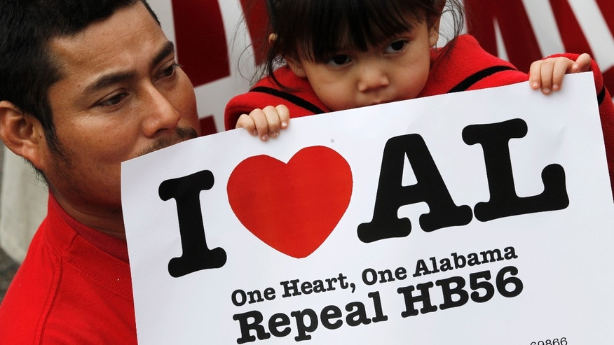 Opponents of Alabama's immigration law gather for a rally outside the Statehouse in Montgomery, Ala., on Tuesday, Feb. 14, 2012.  The group was calling for the repeal of HB56 which is considered to be among the strongest immigration laws in the country. (AP Photo/Dave Martin)