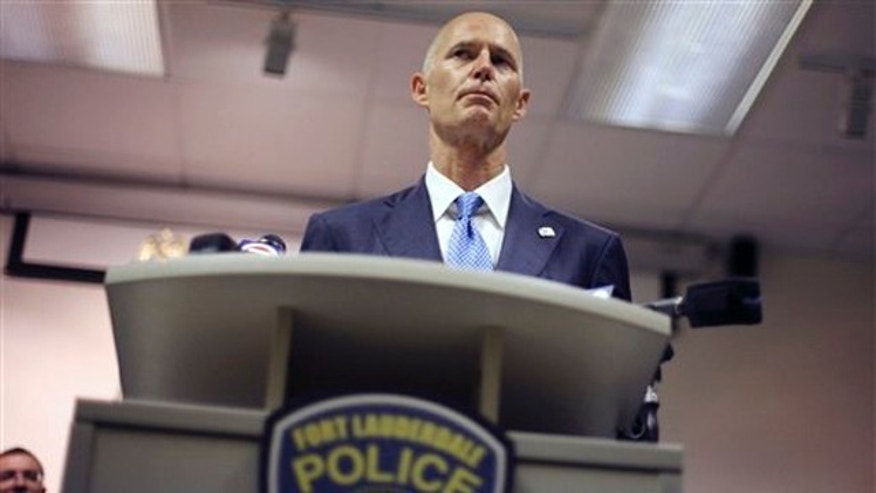 Florida Gov. Rick Scott is shown at a ceremony at a Fort Lauderdale, Fla., police station June 3.