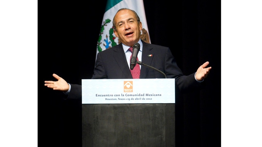 Mexican President Felipe Calderon speaks at the Ripley House community center gymnasium in Houston, Wednesday, April 25, 2012. Calderon spoke to more than 200 Mexican immigrants at the community center in Houston. The speech was part of a daylong visit by Calderon, who also met with local business leaders and Houston's mayor. (AP Photo/Houston Chronicle, Nick de la Torre)