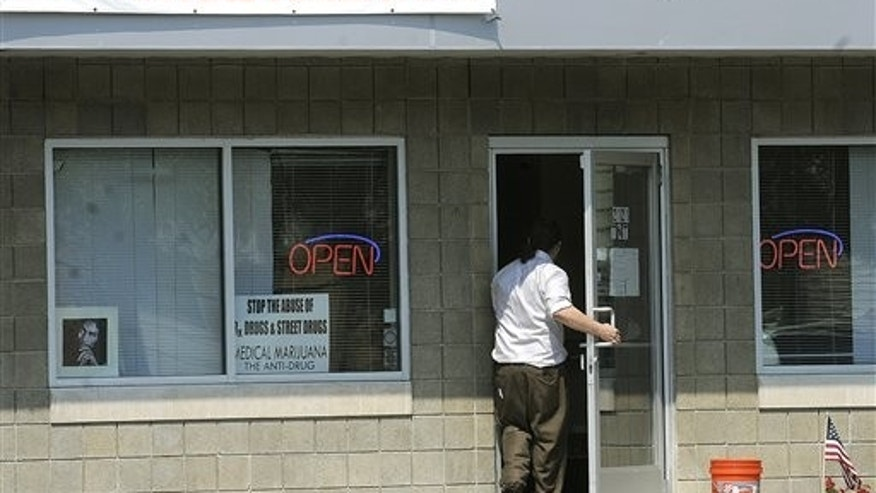 August 24: A man walks into TNT, a medical marijuana dispensary on Michigan Avenue in Lansing, Mich.