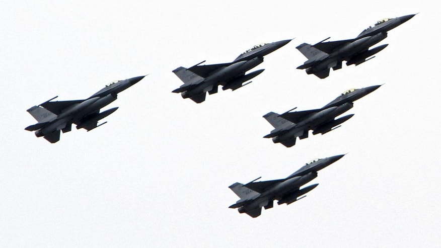 October 10, 2011: Taiwanese F-16 fighter jets fly in formation during national day celebrations of the centenial anniversary of the founding of the Republic of China government in Taipei, Taiwan