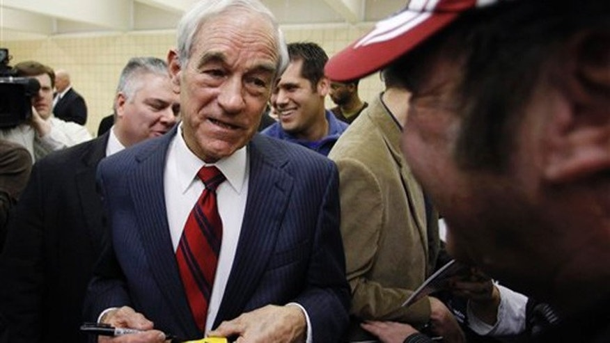 Dec. 30, 2011: Ron Paul signs a toy car during a campaign stop in Le Mars, Iowa.