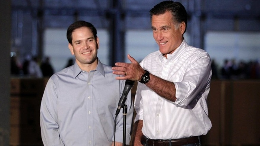 Republican presidential candidate, former Massachusetts Gov. Mitt Romney, accompanied by  by Sen. Marco Rubio, R-Fla., talks to reporters in Aston, Pa., Monday, April 23, 2012. (AP Photo/Jae C. Hong)