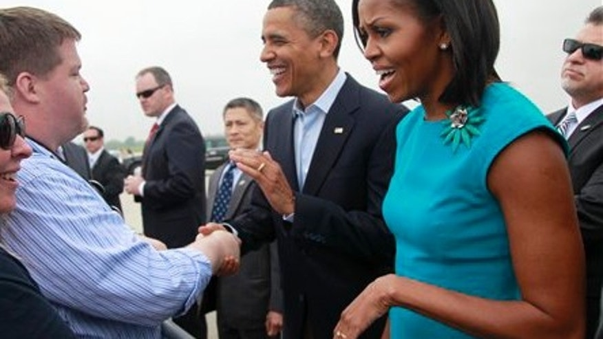 May 5, 2012: President Obama and first lady Michelle Obama arrive in Ohio for a campaign stop at Ohio State University.